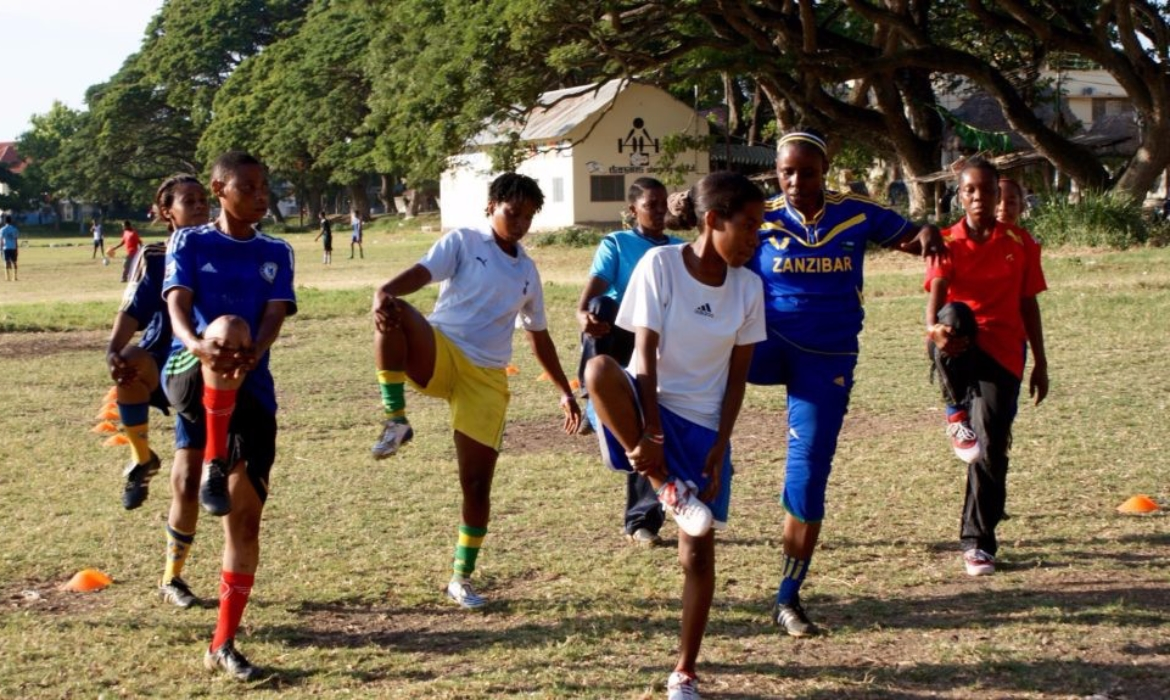 A group of Zanzibari women soccer players stretching before a game of soccer in the island of Zanzibar.